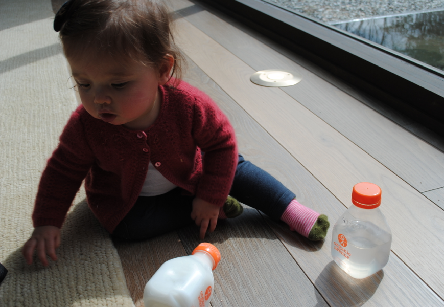 Baby Z loves playing with the bottles, too.