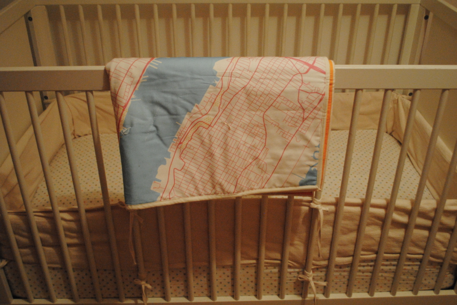 Blanket on crib.