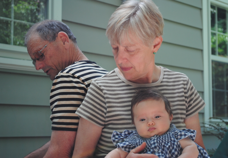 My parents with Baby Z. It is no surprise that I became a fan of stripes....