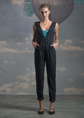 Printed stretch silk jumpsuit in our black/grey totem print.  Deep v-neck.  Slanted front pockets.  Diamond inset in scaled down print at waist.