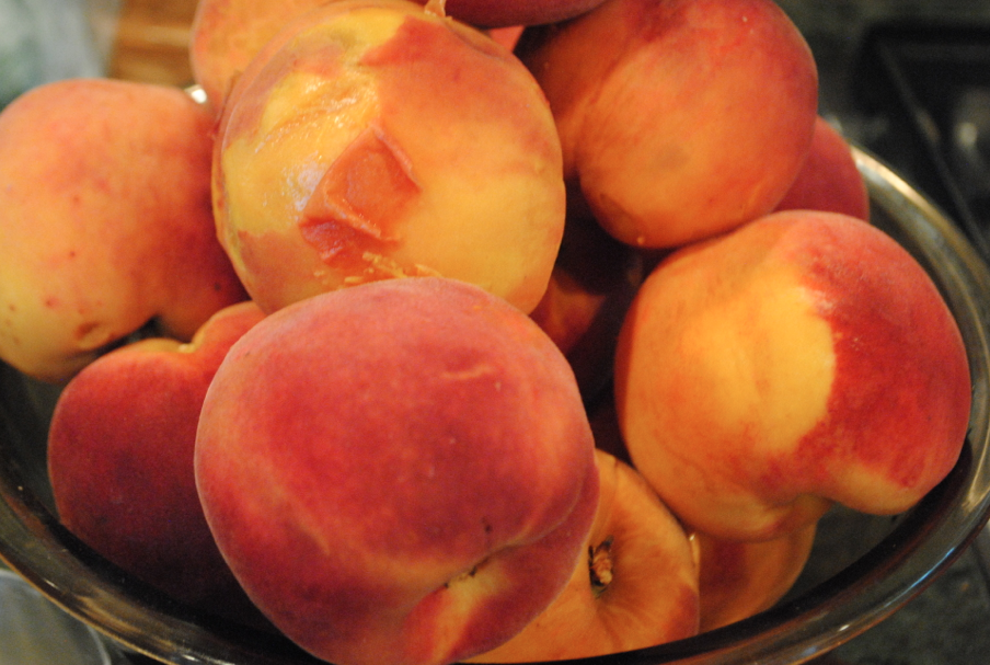Peel the skins of the peaches.