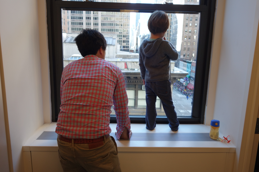 Who says it is dangerous to peer out a window from a tall building?