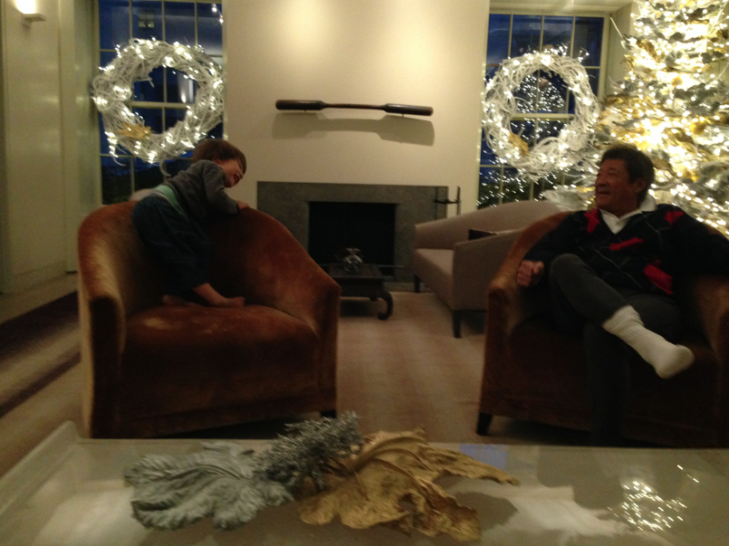 Cruzzie and Gramps Natori chilling in front of the holiday decor.