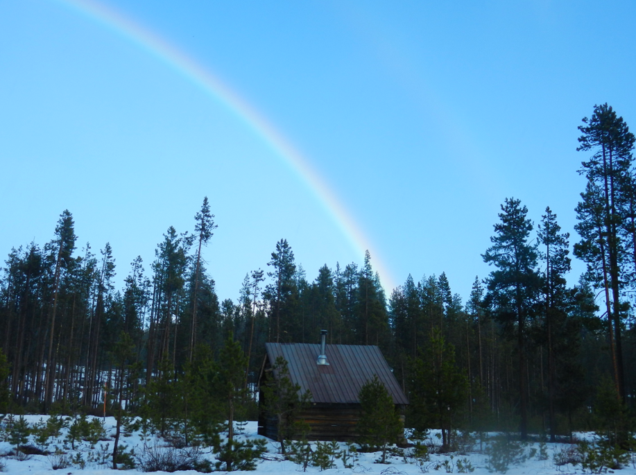 RAINBOW! Over a small log cabin, can this be any more dreamy?