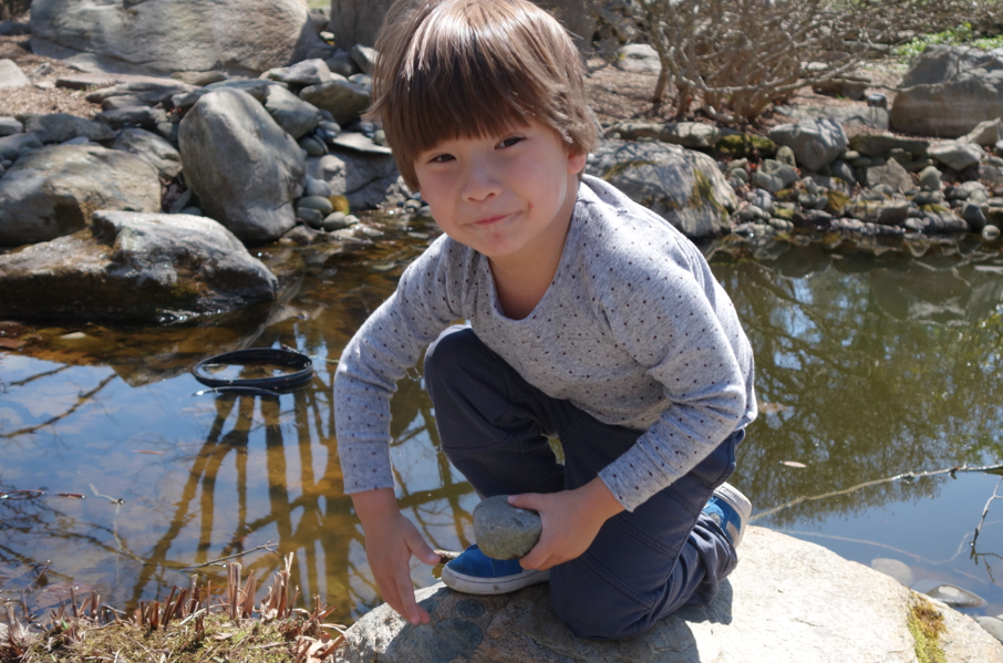 As a typical 4 year old, Cruzzie decides to NOT listen to his papa, and throws the rocks into the pond regardless.