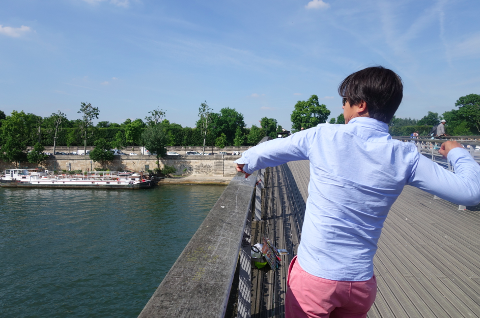 Good arm, Kenny! Throwing the keys to our love lock into the Seine.