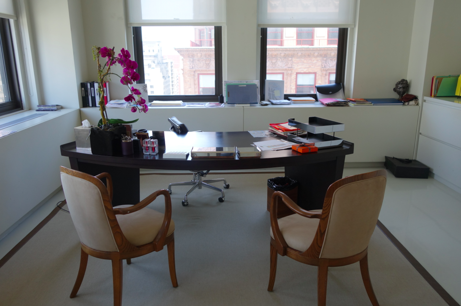 """JCN's desk. Her office is gigantic -- the size of our apartment -- with one side """"his"""" and one side """"hers."""""""