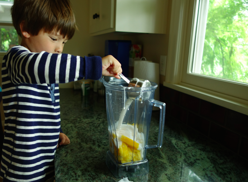 Pour the liquids into the blender, along with the mango.