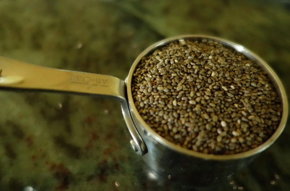 After the milks and mango are blended, add the chia seeds.