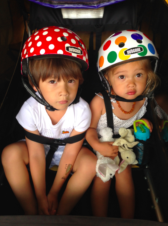 The kids in their bike trailer