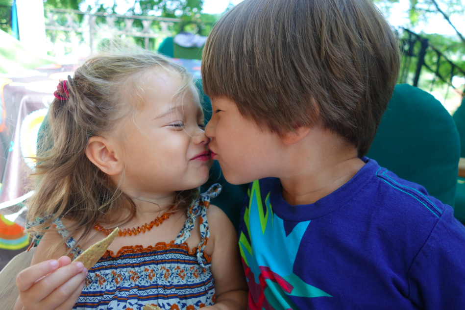 The kids loved the socks so much that they decided to kiss.