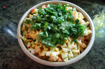 after dressing is added and mixed, add cilantro on top.
