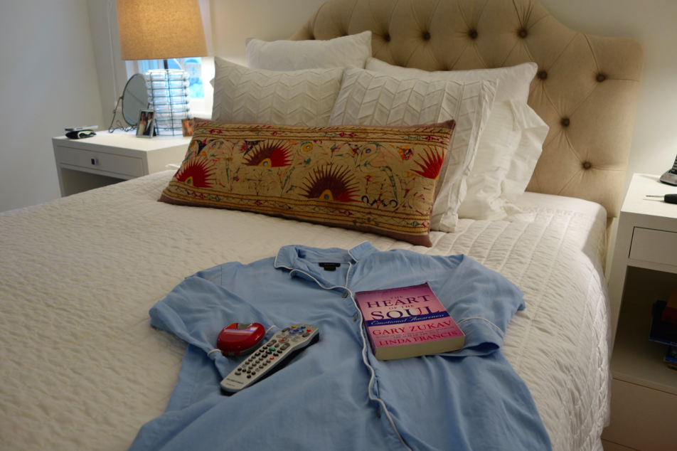 Natori white bedding with Natori sleepshirt.