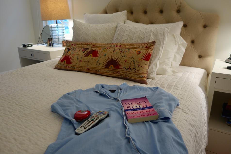 Natori white bedding with Natori sleepshirt.