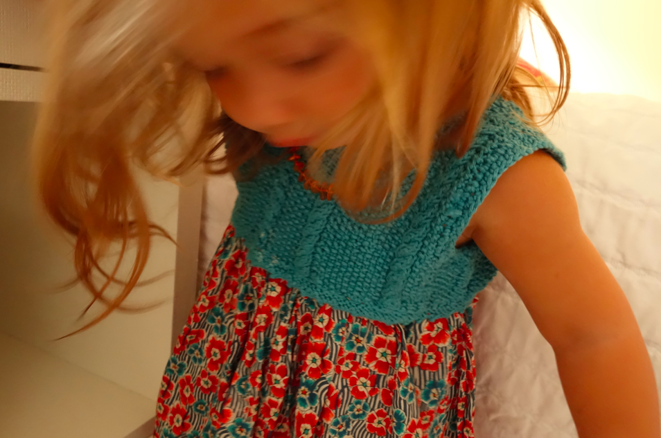 Blurry hair but a clear view of the knit top.