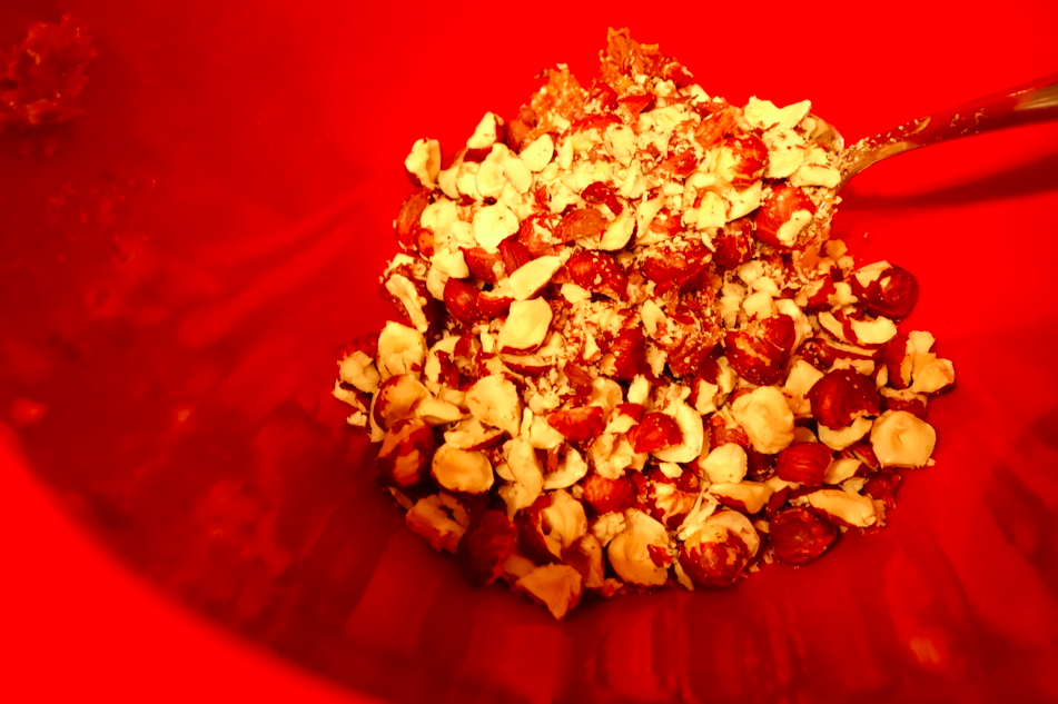 In a bowl, combine the date puree, nuts, and mix.