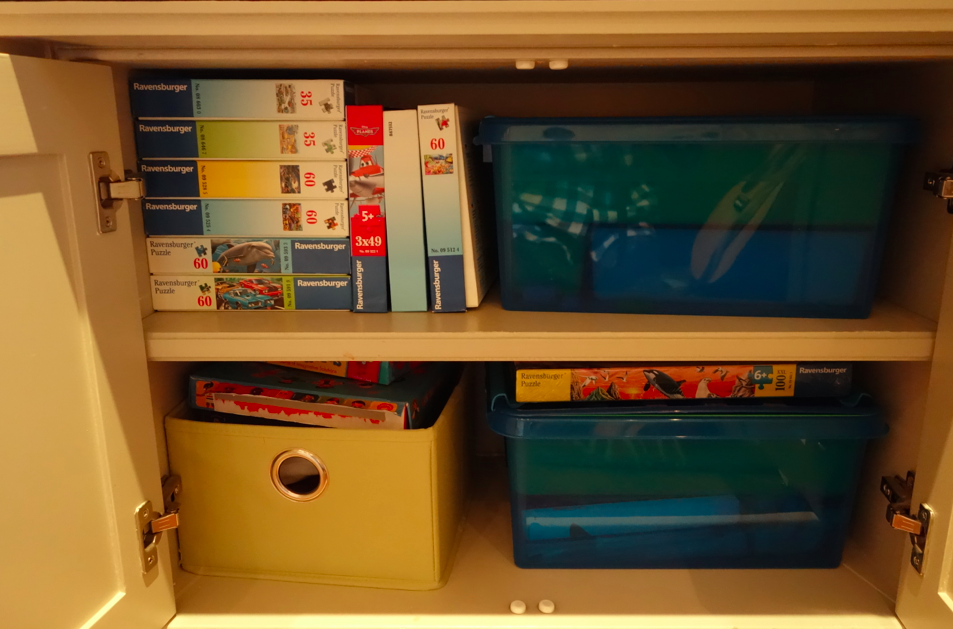 In our NYC tiny apartment, every little nook is used for a purpose. Here is the cabinets filled with the Lego boxes.
