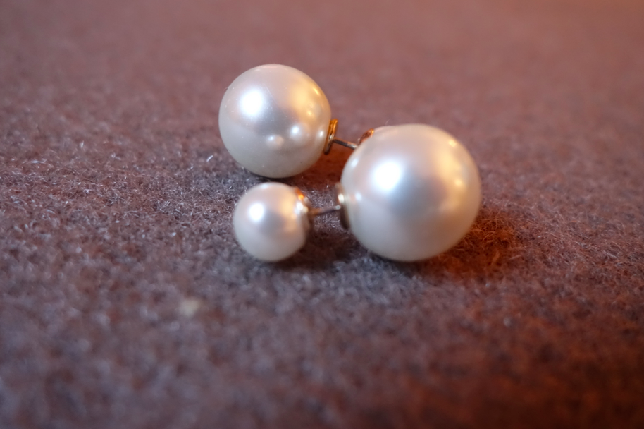 The earrings -- front and back pearls, small and big.