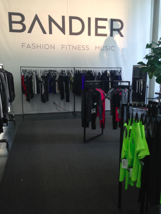 Inside the store -- so many racks with a curated assortment of perfect fitness attire.