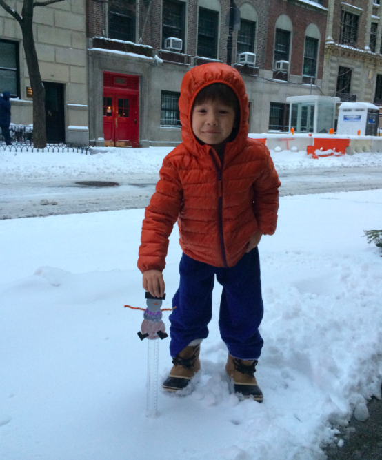 Weatherman Cruz measuring the overnight accumulation in New York: 1.5 inches!