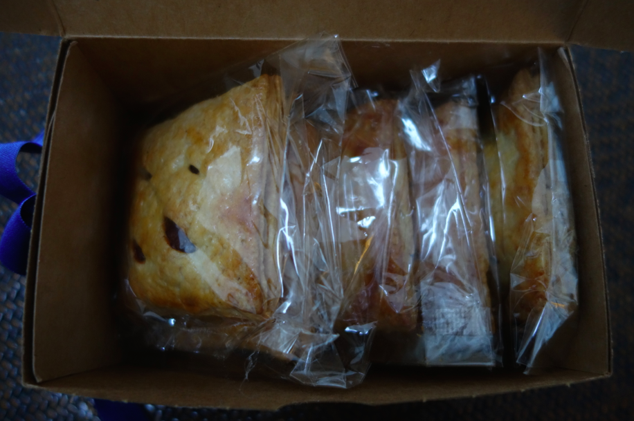 The box contains six individually wrapped pies.
