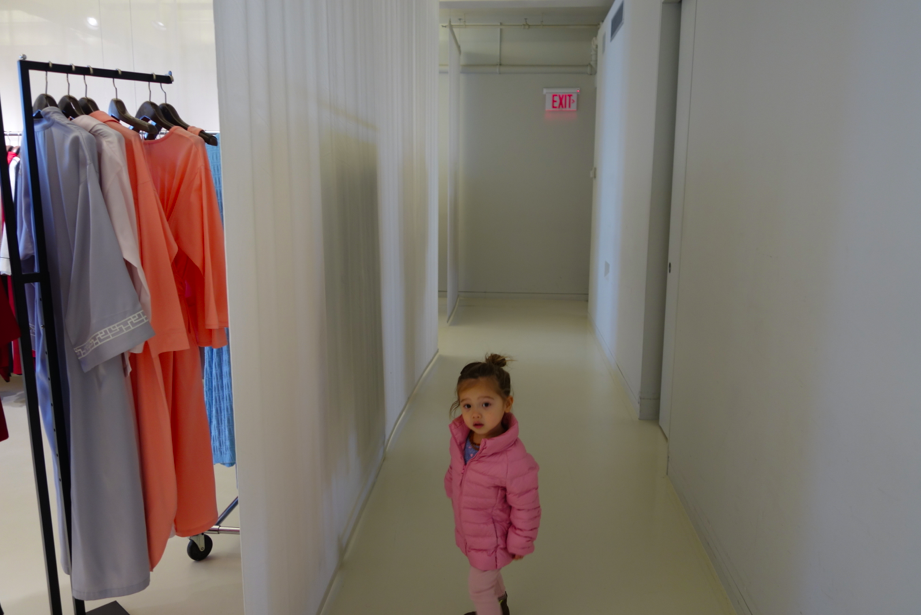 Josie Girl Jr. in hallway of showroom