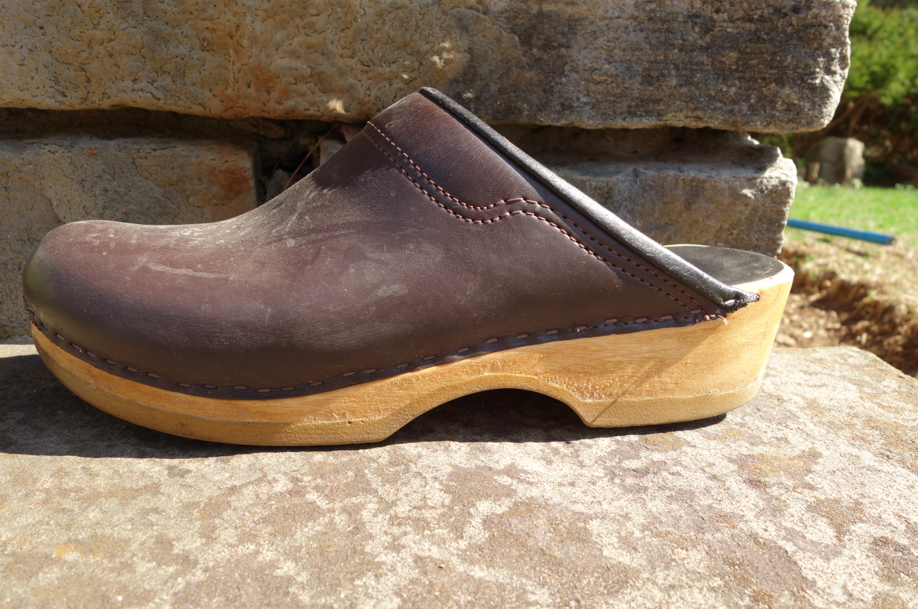 Ken's brown clogs. WHO KNEW that a man in the fashion business would wear clogs as much as he does -- but honestly -- he wears them ALL THE TIME. I would have never pegged him as the type to wear clogs, but once he tried, he fell head over heels in love.