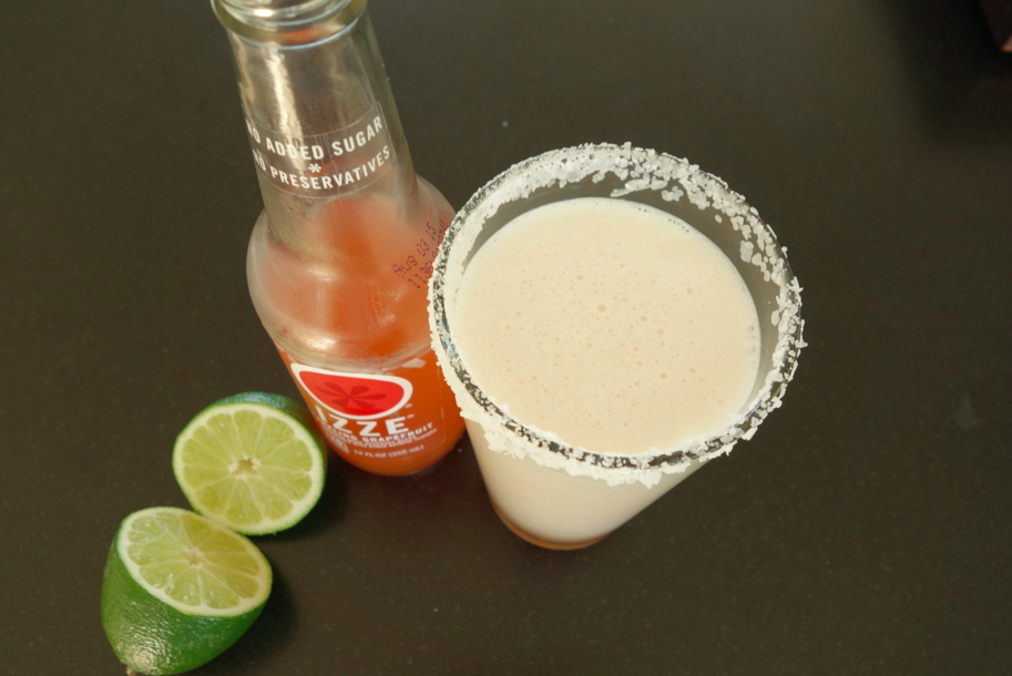 Pour it into the glass, add 6 ounces of grapefruit soda and a large splash of lime.