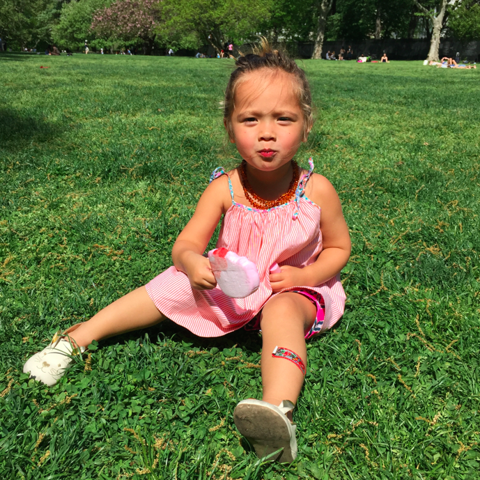 "Big girl Toosh celebrating her birthday and mother's day yesterday eating a ""Hello Kitty"" sorbet and relaxing in Central Park."