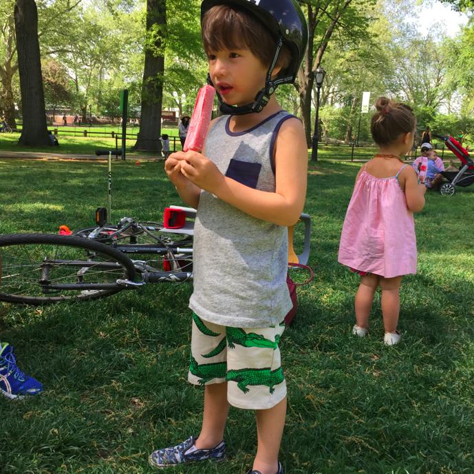 Cruzzie guzzling his popsicle wearing Mini Rodini Crocodile shorts.