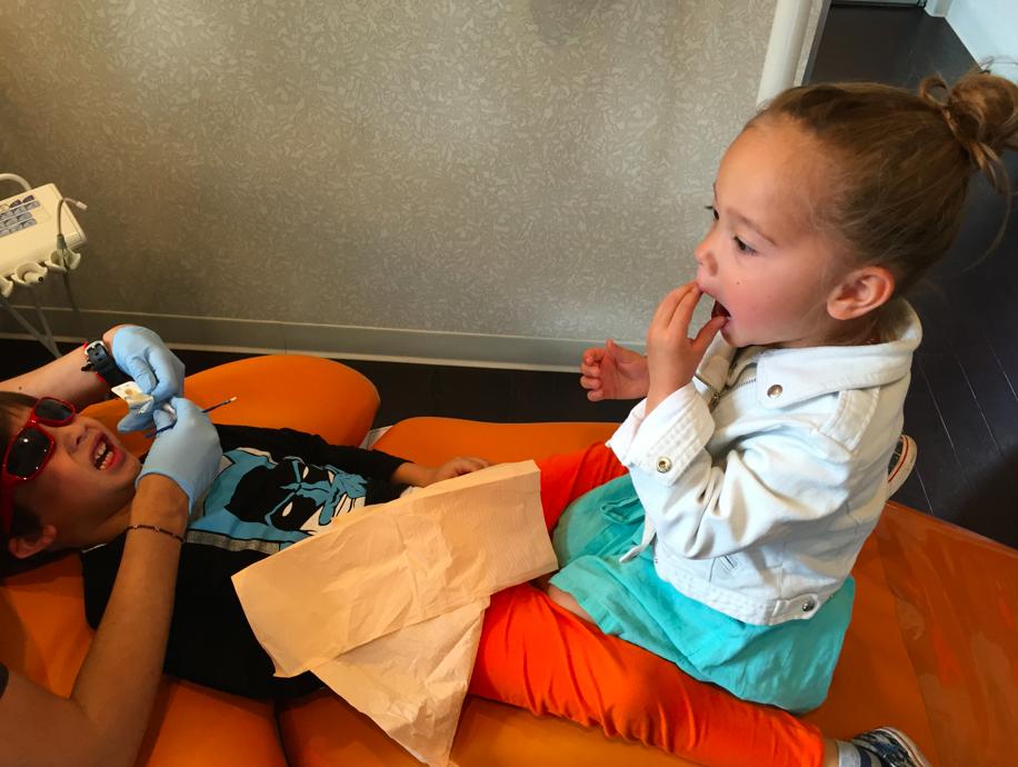 Cruzzie, at the dentist, wearing his Batman shirt!