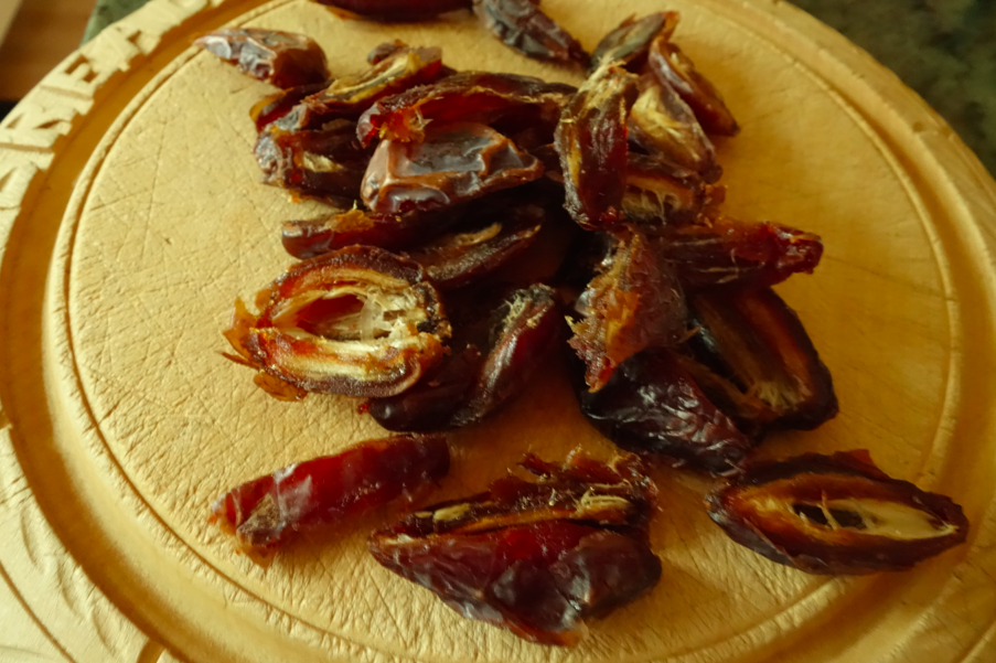 Chop and pit the dates (and try not to eat your stash for the recipe).