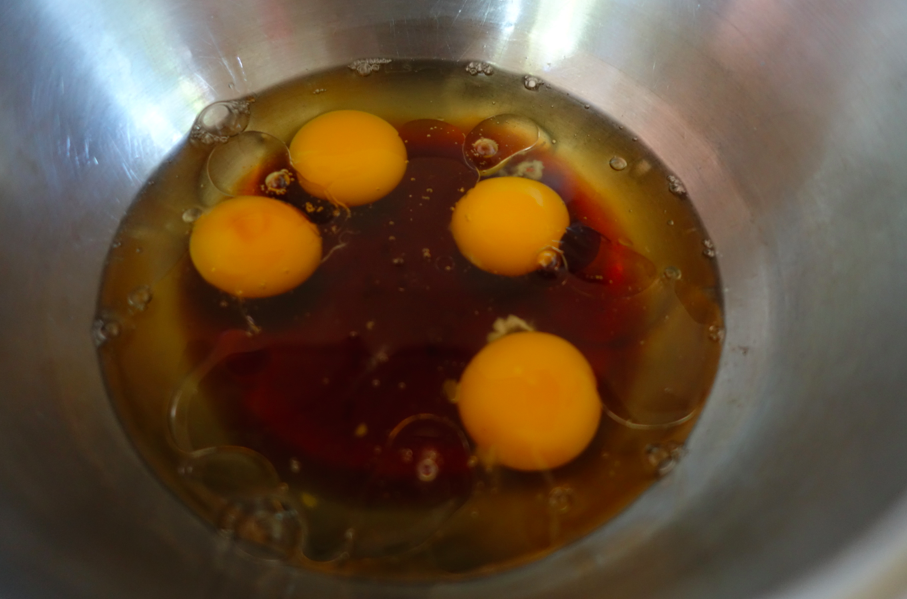 In a separate bowl, combine and whisk the wet ingredients of eggs, maple syrup and coconut oil).