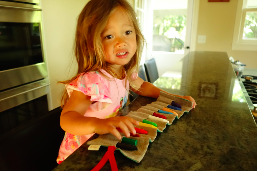 Little girl loves her crayons!