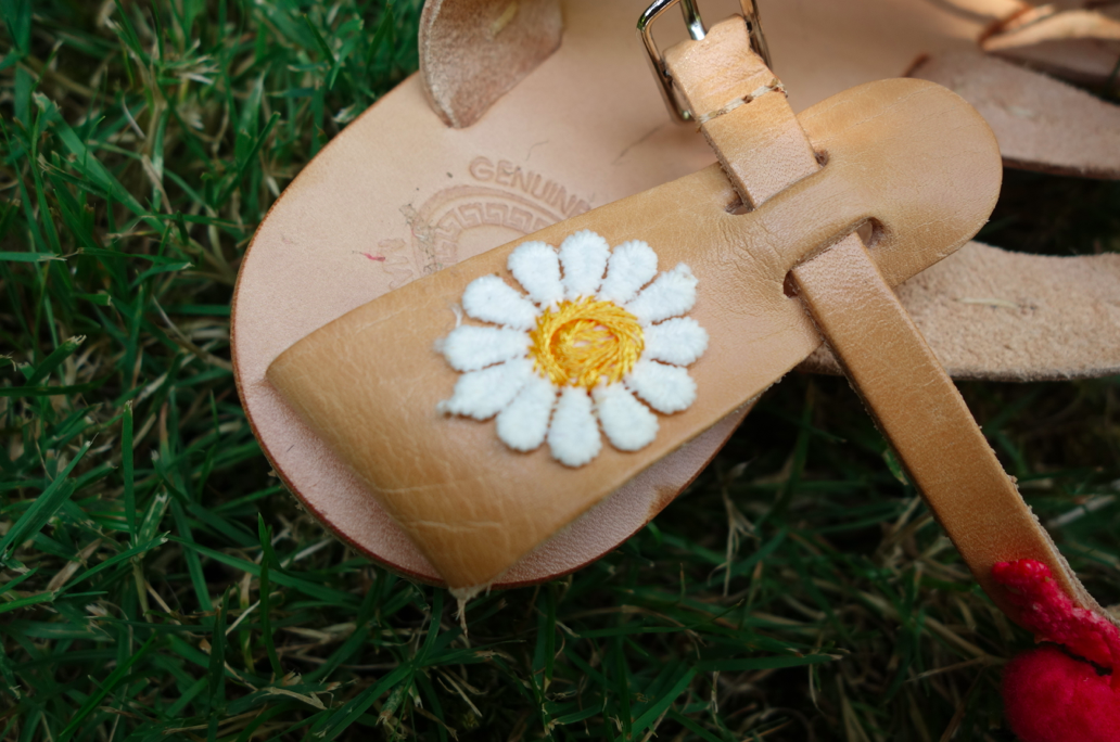 Look at the details! The daisy on the back -- that alone makes me feel head over heels in love with these shoes!