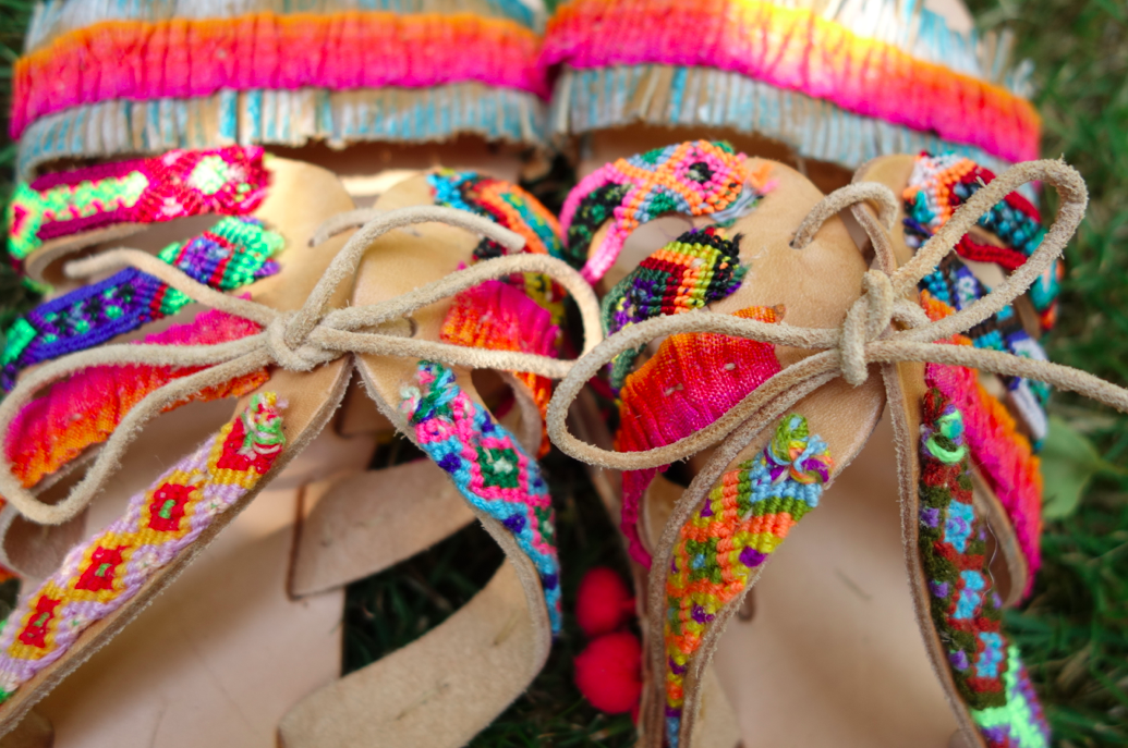 The laces with the friendship bracelets attached.