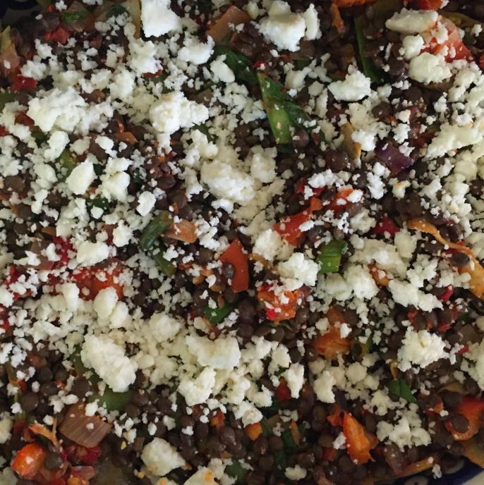 Lentil salad with carrots, sugar snap peas, artichoke hearts, cojita cheese, and sundried pesto.