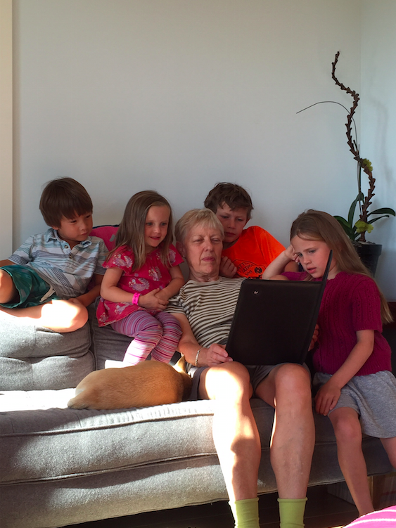 My mom and 4 out of the 5 grandkids watching something on her ipad.