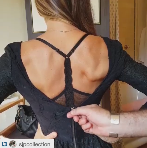 It is actually a video of SJP getting zipped up to make a personal appearance at Bloomingdales, and her bra that is shown is Natori Feathers T-Back!