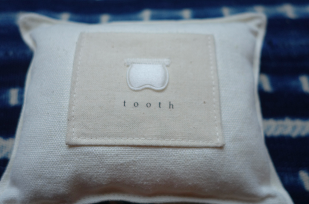 The tooth pillow where we put the tooth overnight.