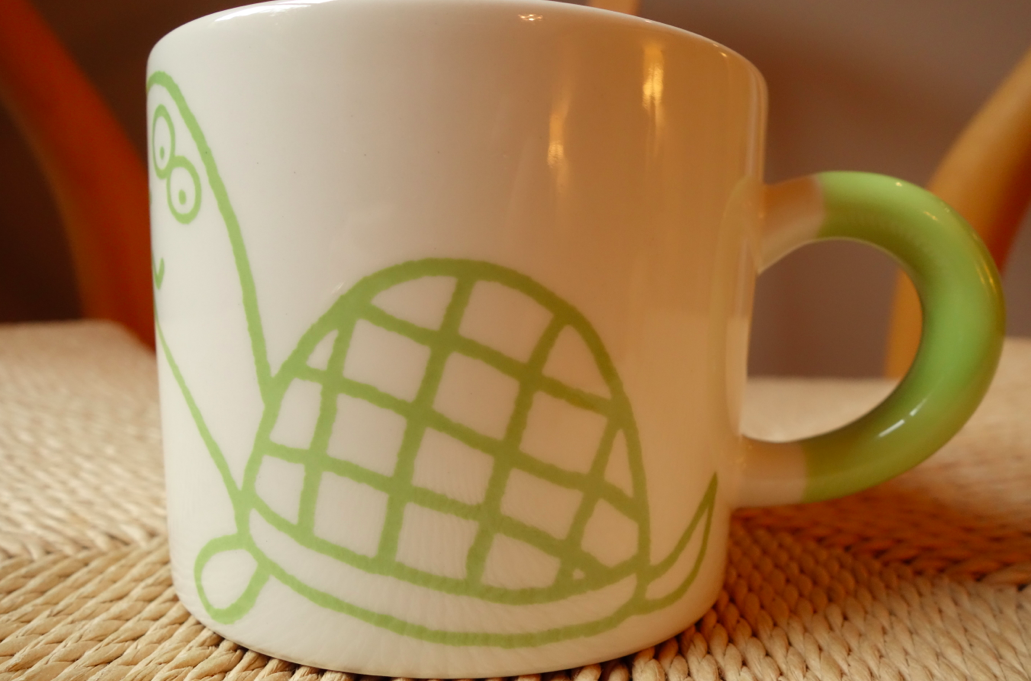 Drinking a green liquid only makes sense to drink it out of a green mug.