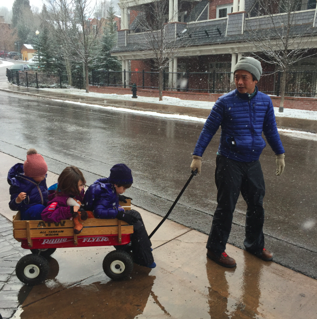 Our mode of transportation for the weekend. Ken's muscles are huge now from pulling the kids around.