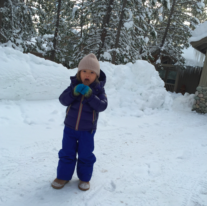 YUP, my little ice cream chocolate lover is eating an ice cream in 20 degree weather on a walk in the snow. #PolarBear