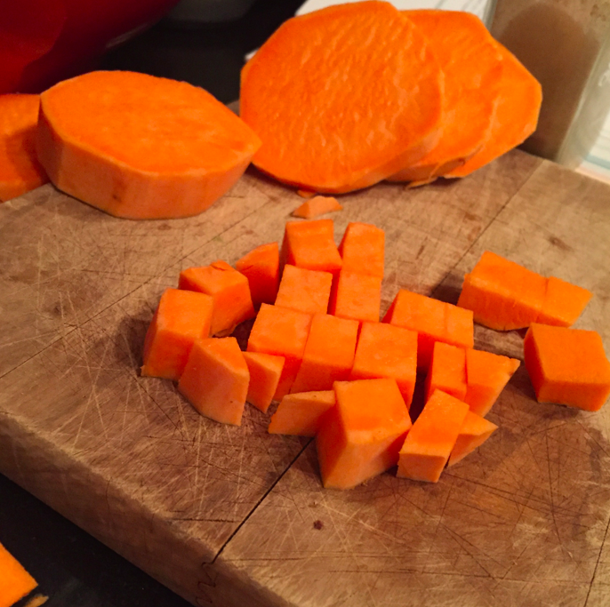 Peel and chop the sweet potatoes.