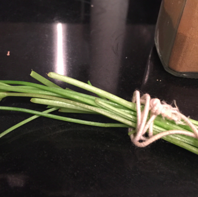 Take 5 sprigs of cilantro and rope them together.