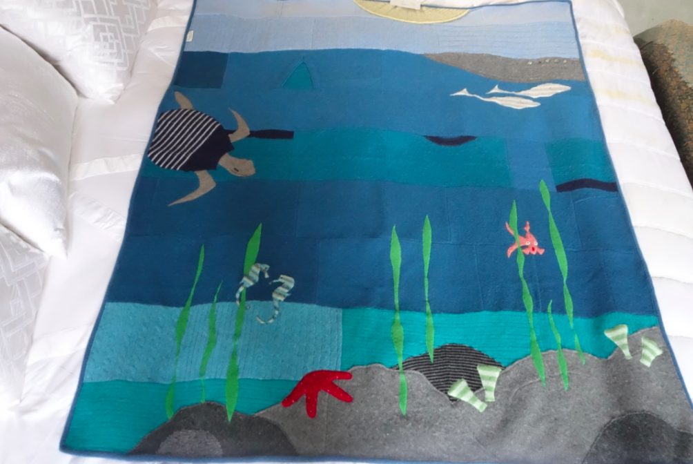 """We had Cruzzie's quilt made into """"Under the Sea,"""" Joan spent over an hour on the phone this past Spring, to get a feel for the children and their interests. In order to create these quilts, she really wanted a sense of who they are and what inspired them. I really enjoyed talking with Joan -- a very sweet woman."""