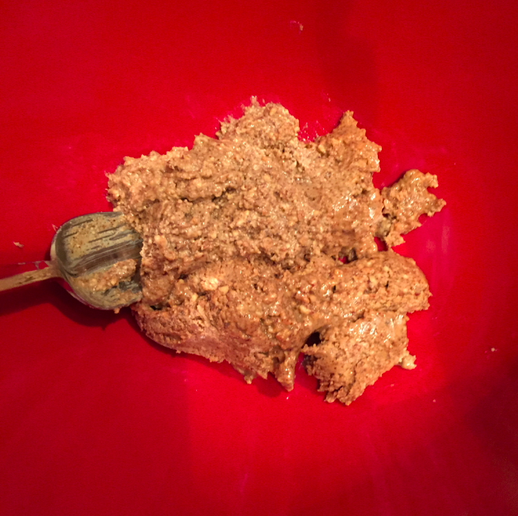 Big hunk of almond butter in a bowl.