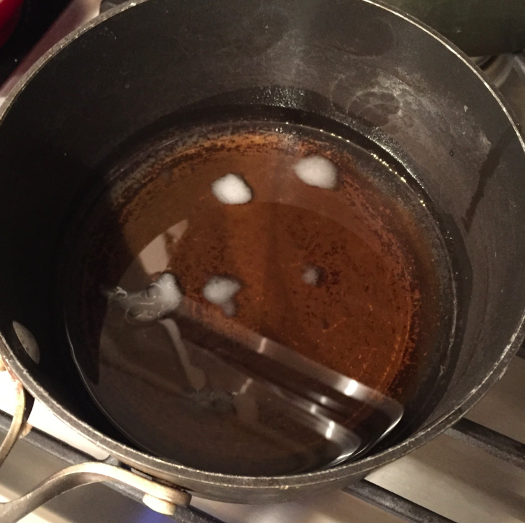 On low heat, melting coconut oil, maple syrup and salt.