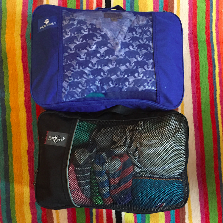 And then ZIP them up, voila! For our 6 day trip, Cruzzie only has these two little bags -- they compress the items and make them so easy to deal with.