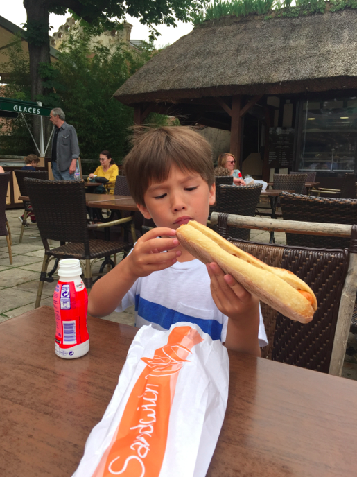 Lunch. A hot dog. On a baguette.